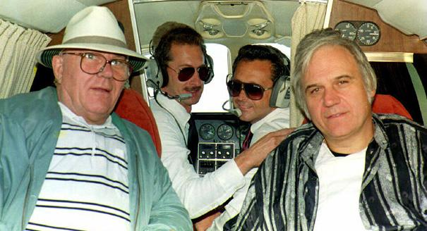 OVER OHIO, IN FLIGHT - SEPTEMBER 22:  OVER OHIO, XIF - SEPTEMBER 22:  Released Israeli prisoner John Demjanjuk (L) poses for a picture during his chartered plane trip to his home state of Ohio, 22 September 1993 with Rep. James Trafficant (R) and pilots Fritz Forsthoefel (2nd from L) and Paul Fiorino. Demjanjuk left the plane and boarded a car to go into hiding.  (Photo credit should read STR/AFP/Getty Images)